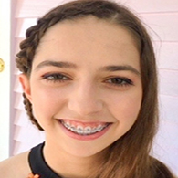 teenage girl with braces and braided hair